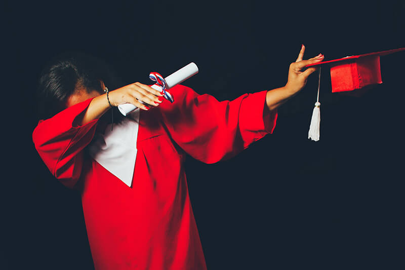 graduating student wearing cap and gown